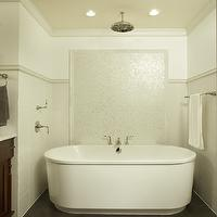 Dreamy cream bathroom design! Rainfall showerhead over modern freestanding bathtub! ...
