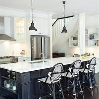 Porchlight Interiors - kitchens - white and black kitchen, glass front cabinets, stainless steel hood, kitchen hood, hood, cabinets, white cabinets, white kitchen cabinets, double door fridge, carrara, carrara marble, carrara marble countertops, countertops, sink in kitchen island, sink, kitchen island, kitchen, black island, black kitchen island, marble top island, marble top kitchen island, bar stools, barstools, counter stools, stools, black bar stools, black barstools, black counter stools, wicker, wicker stools, wicker bar stools, wicker barstools, wicker counter stools, black wicker stools, black wicker bar stools, bronze pendants, kitchen island pendants, glass cabinets, glass front cabinets, kitchen island bookshelf, bookshelf,
