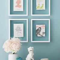 BHG - entrances/foyers - blue walls, turquoise walls, turquoise blue walls, glass picture frames, frames, glass frames, foo dog, white foo dog, lacquer tray, white tray, white lacquer tray, turquoise books, white vase, vase, white and blue vignette,