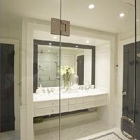 Meredith Heron Design - bathrooms - black and white, black and white room, bathroom, master bath, master bathroom, black and white bathroom, black and white bath, black and white master bath, black and white master bathroom, black doors, bathroom doors, black bathroom doors, black mirror, frames mirror, bathroom mirror, black  bathroom mirror, beveled mirror, black beveled mirror, floating vanity, vanity, bathroom vanity, white vanity, white floating vanity, double sinks, double sink console, floating washstand, floating sink console, floating console sink, floating cabinet, floating bathroom cabinet, white cabinets, white bathroom cabinets, his and her sinks, marble floor, bathroom floor, master bathroom, marble tile, marble tile floor, marble inset tiles, marble mosaic tile, mixed marble floor,