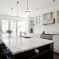 Porchlight Interiors - kitchens - white and black kitchen, calcutta marble, calcutta marble countertops, calcutta marble island, calcutta marble kitchen island, black kitchen island, kitchen island, center island, bar stools, slipcovered bar stools, slipcovered barstools, slipcovered stools, slipcovered counter stools, white slipcovered bar stools, white slipcovered barstools, white slipcovered counter stools, white slipcovered stools, island sink, kitchen island sink, vintage faucet, island bookshelf, kitchen island bookshelf, glass front cabinets, glass front kitchen cabinets, glass front upper cabinets, upper cabinets, inset cabinets, white lower cabinets. stainless steel appliances, stainless steel hood, subway tile backsplash, subway tile, glass pendants, kitchen island pendants, french doors, kitchen french doors,
