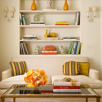 Kristen Buckingham Interior Design - living rooms - yellow accents, built in niche, built in nooks, built in shelving, slipcovered sofa, slipcovered, sofa, striped pillows, yellow and brown pillows, yellow and brown striped pillows, brass, coffee table, brass coffee table, glass top, glass top coffee table, orange accents,
