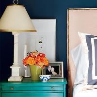 Amazing bedroom with peacock blue walls paint color and West Elm nailhead ...