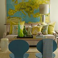 Lisa Sherry Interieurs - living rooms - blue and yellow, blue and yellow living rooms, blue plastic chairs, modern blue chairs, white and blue throws, striped throws, natural fiber rugs, oatmeal sofas, yellow and blue pillows, blue glass bottles, green glass bottles, silver column lamps, world map art,