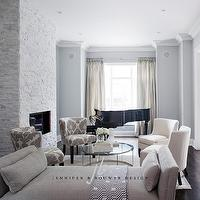 Jennifer Brouwer Design - living rooms - silver glitter panels, silver glitter art panels, art flanking fireplace, loung living rooms, black grand piano, living room pianos, grand piano, pianos in living rooms, pinch-pleat drapes, silk drapes, two-tone drapes, silk two-tone drapes, silk pinch-pleat drapes, two-tone pinch pleat drapes, gray linen settee, contemporary settees, gray blue paint colors, gray blue paints, gray blue living rooms, gray blue living room walls, floor to ceiling fireplaces, contemporary fireplaces, white stone fireplaces, circular furniture arrangement, glass-top coffee tables, polished nickel coffee tables, barrel back chairs, white barrel back chairs, gray barrel back chairs, gray living room chairs, gray living room furniture, blue and gray living room, gray and bleu living room,