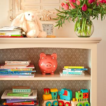 Amy Meier Design - nurseries: nursery bookcase, ivory nursery bookcase, bookcase lined with paper, choo choo train, pink ceramic piggy bank, pink piggy bank, floppy bunny, floppy eared bunny, floppy eared rabbit, ivory nursery mirrors, nursery mirrors, french mirrors, vintage french mirrors,
