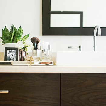 Design Sponge - bathrooms - contemporary bathrooms, espresso stained bathroom vanity, espresso bathroom cabinets, light stone countertops, light stone bathroom counters, black bathroom mirrors, ebony bathroom mirrors, white porcelain sinks, bathroom sinks, vessel sinks, vessel bathroom sinks, bathroom vessel sinks, polished nickel bathroom faucets, bathroom faucets, mirrored bathroom tray, vignette, espresso bathroom vanity,