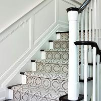 Jennifer Worts Design - entrances/foyers - second floor landings, wainscoted walls, wainscoting, second floor landing wainscoting, stairwell wainscoting, glossy black handrail, black staircase railings, white spindles, gray stair runner, contemporary stair runners, geometric stair runners, gray geometric stair runners,