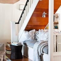 Jennifer Worts Design - living rooms - cabin nooks, cabin lounge space, cabin bench, built-in bench, under the stairs bench, under the stairs lounge, gray bench cushions, silver pillows, silver patterned pillows, polished nickel sconces, under stairs bench, under stairs nook,