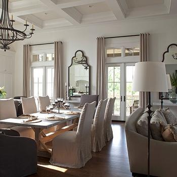 Open plan French kitchen and family room with white coffered ceiling and French ...