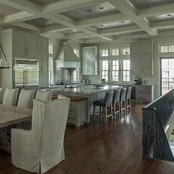 Beautiful open plan second floor gray kitchen with coffered ceiling. Traditional ...