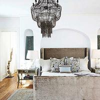 Tracery Interiors - bedrooms - beaded chandelier, bedroom chandeliers, brown chandeliers, brown beaded chandeliers, beaded bedroom chandeliers, bed alcoves, bed niches, bed nooks, arch bed alcoves, arch bed niche, arch bed nooks, arched bed alcoves, arched bed nooks, arched bed niche, velvet bed, mink velvet bed, modern wingback beds, modern wingback headboard, modern wing beds, modern wing headboards, velvet wingback beds, velvet wingback headboards, velvet wing beds, velvet wing headboards, mirrored nightstands, glass column lamps, column table lamps, blue and brown, blue and brown pillows, blue and brown rugs, bedroom rugs, white bedroom walls, wingback upholstered headboard, wingback headboard, brown wingback headboard, brown upholstered headboard, Arteriors Maxim Chandelier, Layla Grayce Huntington Bed,
