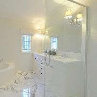 A Welsh Girl in Australia - bathrooms - glass partition, shower partition, glass shower partition, shower subway tiles, white subway tile shower, marble tiles, bathroom marble tiles, marble bathroom floors, spa tub, ivory modern bathrooms, ivory bathroom walls, white roman shades, bathroom roman shades, bathroom window treatments, subway tile backsplash, bathroom subway backsplashes, frameless bathroom mirrors, sconces mounted on mirrors, sconces mounted on bathroom mirrors, his and her sinks, double sinks, white bathroom cabinets, marble bathroom countertops, marble countertops,