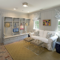 Munger Interiors - laundry/mud rooms - coastal mudrooms, seaside mudrooms, gray mudroom lockers, gray open lockers, gray mudroom lockers, gray mudroom open lockers, beadboard lockers, gray beadboard lockers, gray built-in cabinets, gray mudroom cabinets, gray wood panels, gray mudroom panels, gray wood panels, gray wood panel walls, gray wood paneling, gray mudroom paneling, gray mudroom wood paneling, brick mudroom floor, wedding circles rug, lucite ottomans, lucite cube ottomans, rope handle ottomans, rope handle lucite ottomans, ikea sofa, hovas sofa, cobalt blue, cobalt blue garden stool, gray floral pillows, gray floral roman shades, flush-mount lighting, basil flush mount, mud room lighting, mudroom, mudroom design, mudroom cabinets, mudroom bench, mudroom lockers, mudroom open lockers, mudroom hooks, mudroom cubbies, stained cabinets, stained mudroom cabinets, stained mudroom lockers, mudroom laundry room, laundry room mudroom, mudroom beadboard cabinets, mudroom beadboard paneling, Ikea Hovas Sofa, Visual Comfort Lighting Basil Flush Mount, Lucite Trunk,