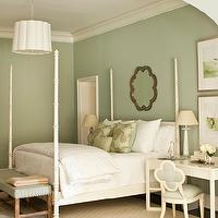 Phoebe Howard - bedrooms - sage green bedrooms, sage green bedroom paint color, sage green paint, scalloped mirrors, scalloped bedroom mirrors, ivory poster beds, four poster beds, ivory four poster beds, green bedroom bench, gray bedroom rugs, geometric rugs, gray geometric rugs, ivory desks, ivory nightstands, quatrefoil chairs, ivory quatrefoil chairs, blue quatrefoil chairs, ivory and blue quatrefoil chairs, bedroom crown moldings, scalloped bedroom chandelier, scalloped chandeliers, white scalloped chandeliers, sage green pillows, white four poster bed, Suzanne Kasler Quatrefoil Alexander Side Chair, Barbara Barry Simple Scallop Chandelier, Caracole Mood Ring Mirror,
