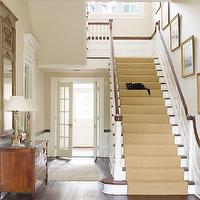 Phoebe Howard - entrances/foyers - stair runner, staircase runner, natural woven stair runner, diamond stair runner, diamond pattern stair runner, staircase art gallery, gold leaf frames, traditional staircases, white spindles, traditional staircase spindles, foyer hardwood floors, antique chest, antique foyer chests, brass hardware, french mirrors, french foyer mirrors, gray french mirrors, gray french foyer mirrors, french foyer doors, foyer french doors, traditional staircase, staircase wainscoting, foyer lanterns, art gallery, staircase art gallery,