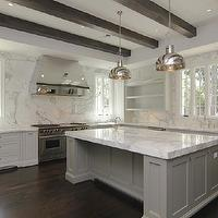 kitchens - gray kitchen islands, gray kitchens, contemporary gray kitchens, gray center islands, perimeter cabinets, shaker perimeter cabinets, white shaker perimeter cabinets, perimeter kitchen cabinets, white perimeter kitchen cabinets, perimeter shaker cabinets, open cabinets, open kitchen cabinets, prep sink kitchen island, espresso box beams, espresso wood beams, kitchen wood beams, kitchen box beams, stainless steel hood, kitchen ladder, dishwashers flanking sink, twin dishwashers, marble kitchen countertops, marble slab backsplash, espresso hardwood floors, espresso kitchen floors, espresso wood floor, kitchen wood floors, two-tone kitchen, two-tone cabinets, polished nickel island pendants, gray kitchen cabinets, gray cabinets,