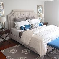 Erin Gates Design - bedrooms - blue and gray, blue and gray bedrooms, blue and gray bedroom colors, blue and gray color combo, blue bedroom walls, blue bedroom color, blue bedroom paint, blue bedroom walls, light gray headboard, velvet headboard, tufted headboard, light gray velvet headboard, light gray tufted headboard, light gray velvet tufted headboard, teal, teal bolster pillow, teal velvet pillow, gray pillows, gray sheets, white hotel bedding, modern bedroom bench, teal velvet bench, teal bench, teal modern bench, teal bedroom bench, gray rug, patterned rug, gray patterned rug, espresso nightstands, x-base nightstands, expresso x-base nightstands, fabric art, fabric panels, fabric panel art, teal bedrooms, gray bedrooms, gray and teal bedrooms, teal and gray bedrooms, peacock blue bedrooms, peacock and gray bedrooms, Madeline Weinrib Atelier Platinum Mandala Rug, Williams-Sonoma Hudson Side Table,