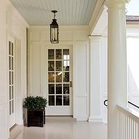 Old House - porches - elegant covered porch, covered porch, beadboard ceiling, blue beadboard ceiling, porch ceiling, blue porch ceiling, beadboard porch ceiling, blue beadboard porch ceiling, iron lanterns, porch lanterns, glass entry doors, glass-front doors, planter box, black planter boxes,