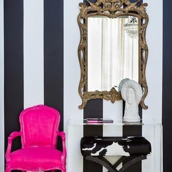 House of Honey - entrances/foyers - black and white foyer, striped walls, black and white stripe walls, black and white striped walls, vertical stripe walls, vertical striped walls, black and white vertical stripe walls, black and white vertical striped walls, bergere chair, french chair, pink bergere chair, pink french chair, cowhide ottoman, black and white ottoman, black and white cowhide ottoman, x-base ottoman, black and white x-base ottoman, acrylic console table, gilded foyer mirror, concrete floors, concrete foyer floor, hot pink accent chair, CB2 Peekaboo Clear Console Table,