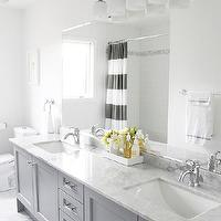 AM Dolce Vita - bathrooms - Benjamin Moore - Pigeon Gray - Gray Yellow Bathroom, Bianco Carrara floor, Vanity in Benjamin Moore Pigeon Gray, bianco statuario countertop, bianco statuario marble, Kohler Fairfax lavatory faucets, Stacked 4x16 white subway tiles Carrara border, gray bathrooms, gray bathroom cabinets, double bathroom vanity, gray double bathroom vanity, modern gray bathroom cabinets, bianco statuario, bianco statuario bathroom countertops, double sinks, stripe shower curtain, white and gray, striped shower curtain, white and gray shower curtain, gray contemporary bathrooms, contemporary gray bathrooms, gray bathroom, gray bathroom cabinets, gray bathroom vanity, bianco carrara, bianco carrara marble, bianco carrara marble floor, bianco carrara tile bathroom,