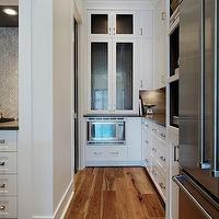 Veranda Interiors - kitchens - microwave nook, low microwave nook, white kitchen cabinets, glass-front kitchen cabinets, white glass-front kitchen cabinets, white glass-front cabinets, french-door fridge, french door refrigerator, white kitchen cabinets, white built-in cabinets, white built-in kitchen cabinets, kitchen shelves, white kitchen shelves, kitchen nooks, rustic kitchen floor, rustic hardwood floor, rustic wood floor, rustic kitchen wood floor, rustic kitchen hardwood floor,