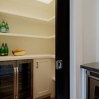 Veranda Interiors - kitchens - pantry, kitchen pantry, pocket door, pantry pocket door, kitchen pocket door, kitchen pantry pocket door, black kitchen door, black pocket door, black pantry pocket door, black kitchen pantry pocket door, pantry shelves, wraparound shelves, wraparound kitchen shelves, wraparound pantry shelves, pantry fridge, pantry refrigerator, pantry mini-fridge, pantry cabinets, white pantry cabinets, pantry floors, pantry wood floors, pantry hardwood floor, microwave nook, mini-fridge, glass-front mini-fridge,