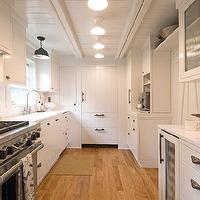 Hampton Design - kitchens - galley kitchen, white galley kitchen, wood plank ceiling, white wood plank ceiling, plank ceiling, white plank ceiling, wood plank kitchen ceiling, plank ceiling, white plank ceiling, plank ceiling kitchen, white kitchen cabinets, cottage kitchen cabinets, quartz countertops, white quartz countertops, quartz kitchen countertops, kitchen hood, hood cabinets, kitchen hood cabinets, kitchen hood kitchen cabinets, gooseneck faucet, gooseneck kitchen faucet, wood plank refrigerator, plank refrigerator, wood plank fridge, plank fridge, galley kitchen, white galley kitchen, cottage galley kitchen, galley kitchen design, galley kitchen cabinets, white galley cabinets, white galley kitchen cabinets, glass front galley cabinets, glass front galley kitchen cabinets,