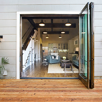 Sutro Architects - decks/patios - folding doors, folding glass doors, patio doors, folding patio doors, folding glass patio doors, modern patio doors, modern folding doors, gray siding, patio lanterns, iron patio lanterns, wood deck, modern wood deck,