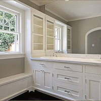 Elegant ensuite bathroom with gray paint color and arched bathroom doorway. White double ...