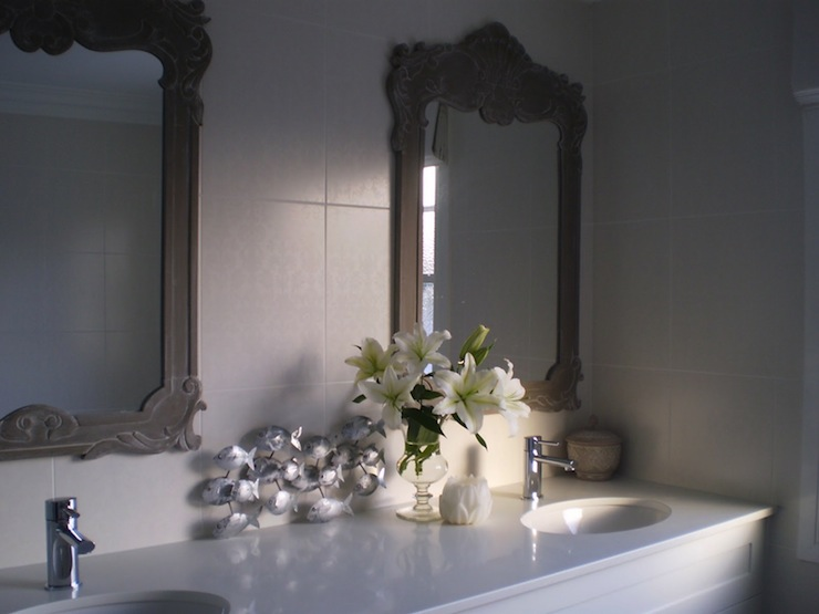 Gray Ornate Mirror = Transitional bathroom The House