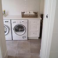 The House That AM Built - laundry/mud rooms - modern laundry room, white washer and dryer, white front load washer and dryer, front-load washer and dryer, white laundry room cabinets, laundry room storage, laundry room built-ins, laundry room built-in cabinets, woven baskets, laundry room baskets, laundry room woven baskets, laundry room storage baskets, subway tiles, subway tile backsplash, laundry room subway tiles, laundry room floor, laundry room tiles, pocket doors, laundry room pocket doors, gray laundry room floor tiles, gray tile, gray slate tile, slate tile floor,