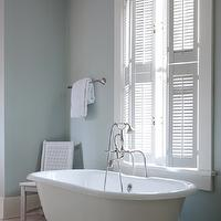 Beth Haley Design - bathrooms - blue bathroom spa like bathroom blue spa like bathroom, blue bathroom color, blue bathroom walls, blue bathroom paint, blue bathroom paint color, soaking tub, blue walls, blue paint, freestanding tub, plantation shutters, bathroom plantation shutters, can chair, white cane chair, polished nickel tub filler, floor-mount tub filler, polished nickel floor-mount tub filler, spa like bathroom,