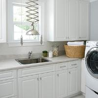 Liz Carroll Interiors - laundry/mud rooms - adjustable pendant, adjustable laundry pendant, gray laundry room color, gray laundry room paint, gray laundry room walls, white laundry room cabinets, laundry room cabinets, laminate countertops, laundry room countertops, gray laundry room countertops, gray laminate laundry room countertops, herringbone, herringbone tiles, laundry room herringbone tiles, herringbone tile backsplash, herringbone laundry room backsplash, herringbone laundry room tiles, white front-load washer and dryer, laundry room cabinets, white laundry room, white laundry room cabinets, Arteriors Farley Polished Nickel Adjustable Pendant,
