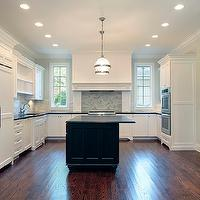 Oxford Development - kitchens - perimeter cabinets, perimeter kitchen cabinets, white perimeter kitchen cabinets, black kitchen island, black center island, absolute black granite, absolute black granite countertops, honed black granite, honed black granite countertops, honed countertops, honed black countertops, honed kitchen countertops, wood kitchen hood, herringbone tiles, herringbone backsplash tiles, herringbone cooktop backsplash, herringbone kitchen tiles, glass-front cabinets, french-door refrigerator, herringbone tile backsplash, Restoration Hardware Clemson Pendant,