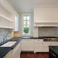 Oxford Development - kitchens - perimeter cabinets, perimeter kitchen cabinets, white perimeter kitchen cabinets, black kitchen island, black center island, absolute black granite, absolute black granite countertops, honed black granite, honed black granite countertops, honed countertops, honed black countertops, honed kitchen countertops, wood kitchen hood, herringbone tiles, herringbone backsplash tiles, herringbone cooktop backsplash, herringbone kitchen tiles, plate rack, kitchen plate rack, marble subway tiles, herringbone backsplash, marble tile herringbone backsplash, marble herringbone backsplash, kitchen herringbone backsplash, herringbone kitchen backsplash, cooktop herringbone backsplash, herringbone cooktop backsplash,
