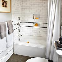 Laura Martin Bovard Interiors - bathrooms: modern bathroom, rubber ducky bathroom, white and gray, white and gray bathroom, white and gray modern bathroom, drop-in tub, subway tiles, subway tile shower surround, subway tile shower, bathroom subway tiles, subway tile backsplash, shower curtain, gray towels, rubber ducky, rubber duckies, bathroom art, white subway tiles, white subway tile shower,