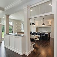 Oxford Development - kitchens - hicks pendants, open floor plan, blue counter stools, blue island stools, blue kitchen island stools, kitchen island sink, two-tone kitchen, two-tone cabinets, two-tone kitchen cabinets, white kitchen cabinets, kitchen hood, wood kitchen hood, white wood kitchen hood, dark stained kitchen island, dar stained island, kitchen shelving, open shelving, kitchen open shelving, veined countertops, veined stone countertops, floor to ceiling kitchen cabinets, floor to ceiling white kitchen cabinets, pass through, kitchen pass through, Visual Comfort Lighting Hicks Pendant,
