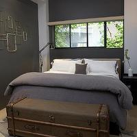 bedrooms - contemporary bedroom, gray bedroom, contemporary gray bedroom, gray walls, gray paint, west elm headboard, headboard nailhead trim, gray bedding, trunk, storage trunk, vintage trunk, vintage storage trunk, patterned rug, gray patterned rug, bedroom rug, patterned bedroom rug, gray bedroom rug, gray and black bedroom, black and gray bedroom,