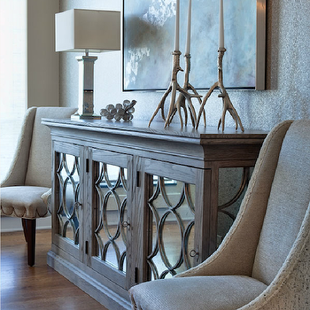 Buckingham Interiors - entrances/foyers - elegant foyer, mirrored cabinet, mirrored circles cabinet, mirrored wood cabinet, mirrored wood circles cabinet, branch candleholders, silver branch candleholders, abstract art, foyer art, foyer abstract art, gray foyer chairs, gray accent chairs, nailhead trim, brass nailhead trim, chair nailhead trim, gray chair nailhead trim, coffee stained hardwood floors, oak wood floors, oak hardwood floors, wood mirrored buffet,