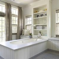 Master bathroom with French doors and transom windows covered in floor to ceiling taupe ...