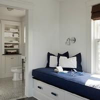 LDa Architects - bedrooms - nautical window seat, window seat, blue cushion, white and blue, white and blue pillows, bamboo roman shade, marine sconces, window seat, bedroom window seat, window seat in bedroom, built in window seat,