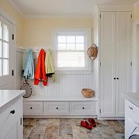 LDa Architects - laundry/mud rooms - built-ins, mud room built-ins, built0in cabinets, mud room built-in cabinets, white mud room built-ins, yellow mud room, cottage mud room, yellow walls, yellow paint, mud room cabinets, white mud room cabinets, shaker cabinets, white shaker mud room cabinets, beadboard walls, mud room beadboard, mud room beadboard walls, mud room beadboard backsplash, gray countertops, gray mud room countertops, mudroom, mudroom design, mudroom cabinets, mudroom bench, mudroom lockers, mudroom locker cabinets, mudroom hooks, mudroom cubbies, stained cabinets, stained mudroom cabinets, stained mudroom lockers, mudroom laundry room, laundry room mudroom, mudroom beadboard panels, mudroom beadboard trim, mudroom beadboard paneling,