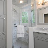 Kitchen Studio of Glen Ellyn - bathrooms - gray bathroom, gray bathroom cabinets, gray bathroom vanity, carrara marble, carrara marble countertop, gray bathroom mirror, gray framed mirror, gray framed bathroom mirror, glass shower, marble tiles, marble shower, marble shower tiles, bathroom sconces, bathroom double sconces, mosaic penny tiles, mosaic penny tile floor, mosaic penny tile bathroom floor, mosaic penny bathroom floor,