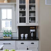Kitchen Studio of Glen Ellyn - kitchens - coffee station, oil-rubbed bronze, oil-rubbed bronze hardware, lined kitchen cabinets, black lined kitchen cabinets, perimeter cabinets, white perimeter cabinets, kitchen island, calcutta marble, calcutta marble countertops, absolute black granite, absolute black granite countertops, glass-front cabinets, recessed lighting, kitchen recessed lighting, pot lights, kitchen pot lights, glass front kitchen cabinets,