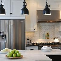 Kitchen Studio of Glen Ellyn - kitchens - chevron tiles, chevron tile backsplash, chevron kitchen tiles, chevron kitchen backsplash, chevron backsplash tiles, chevron cooktop tiles, chevron cooktop backsplash, L shaped kitchen, two-tone kitchen, two-tone cabinets, two-tone kitchen cabinets, perimeter cabinets, white perimeter cabinets, black kitchen island, calcutta marble, calcutta marble countertops, absolute black granite, absolute black granite countertops, counter-depth fridge, yoke pendants, oil-rubbed bronze yoke pendants, calcutta marble island, calcutta marble kitchen island, Visual Comfort Lighting Yoke Pendant,