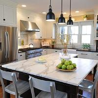 Kitchen Studio of Glen Ellyn - kitchens - L shaped kitchen two-tone kitchen, two-tone cabinets, two-tone kitchen cabinets, perimeter cabinets, white perimeter cabinets, kitchen island, black kitchen island, calcutta marble, calcutta marble countertops, farmhouse sink, apron sink, absolute black granite, absolute black granite countertops, kitchen hood, glass-front cabinets, counter-depth fridge, industrial counter stools, yoke pendants, oil-rubbed bronze yoke pendants, oil-rubbed bronze pedants, oil rubbed bronze island pendants, white and black kitchens, calcutta marble island, calcutta marble kitchen island, Visual Comfort Lighting Yoke Pendant,