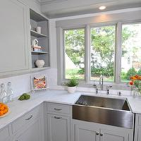 Kitchen Studio of Glen Ellyn - kitchens - gray kitchen, gray kitchen cabinets, gray cabinets, shaker cabinets, gray shaker cabinets, gray shaker kitchen cabinets, carrara marble, carrara marble countertops, stainless steel apron sink, apron sink, bridge kitchen faucet, gray moldings, gray window moldings, open shelving, kitchen open shelving, white subway tiles, white subway tile backsplash, gray green cabinets, gray green kitchen cabinets,