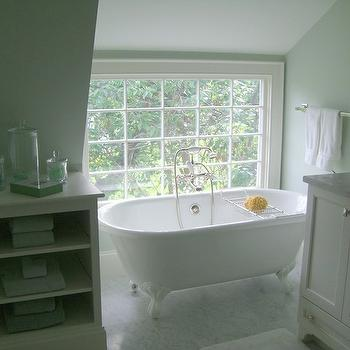 Molly Frey Design - bathrooms - attic bathroom, claw foot tub, vintage claw foot tub, tub in front of window, white bathroom cabinets, single bathroom vanity, marble single bathroom vanity, marble-top bathroom vanity, marble-top single bathroom vanity, marble countertop, marble tiles, marble tile floor, marble bathroom floor, vintage tug filler,