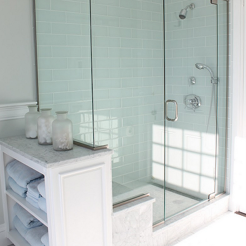 Molly Frey Design - bathrooms - beachy bathroom, seaside bathroom, glass shower, blue subway tile, blue subway tile shower, blue subway shower tiles, blue subway shower, blue glass tiles, blue glass bathroom tiles, blue glass shower tiles, blue glass shower, gray walls, gray paint, marble tiles, marble tile floor, marble bathroom floor, built-ins, bathroom built-ins, bathroom built-in cabinets,